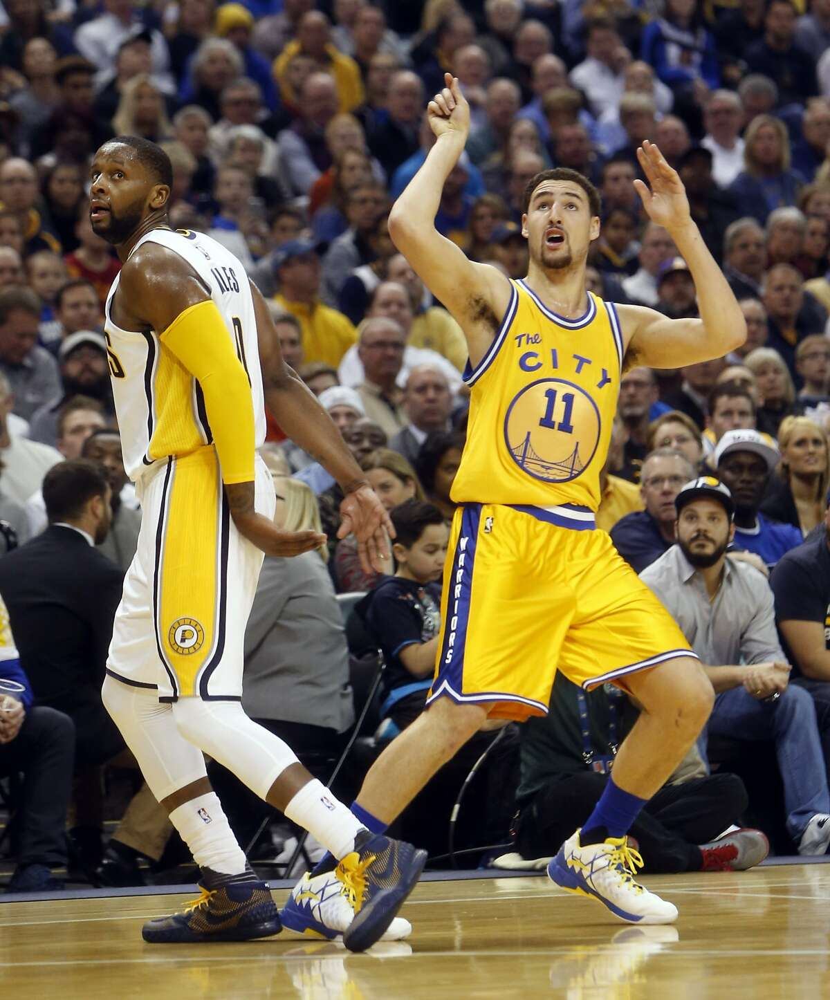 Golden State Warriors' Klay Thompson watches his successful 3-pointer in 2nd quarter against Indiana Pacers' C.J. Miles during NBA game at Bankers Life Fieldhouse in Indianapolis, Indiana on Tuesday, December 8, 2015.
