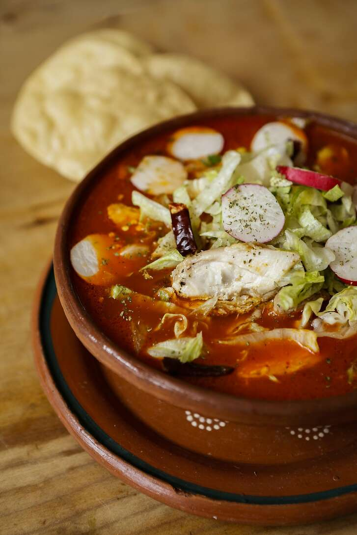Veronica Salazar's of El Huarache Loco posole garnished with arbor chile, lime, lettuce, Mexican oregano, and radishes is seen on Tuesday, Dec. 8, 2015 in Larkspur, Calif.