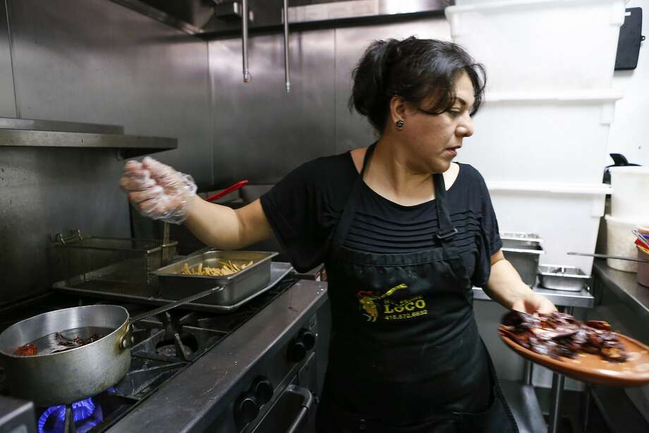 Chef/owner Veronica Salazar of El Huarache Loco makes posole on Tuesday, Dec. 8, 2015 in Larkspur, Calif. Photo: Russell Yip, The Chronicle