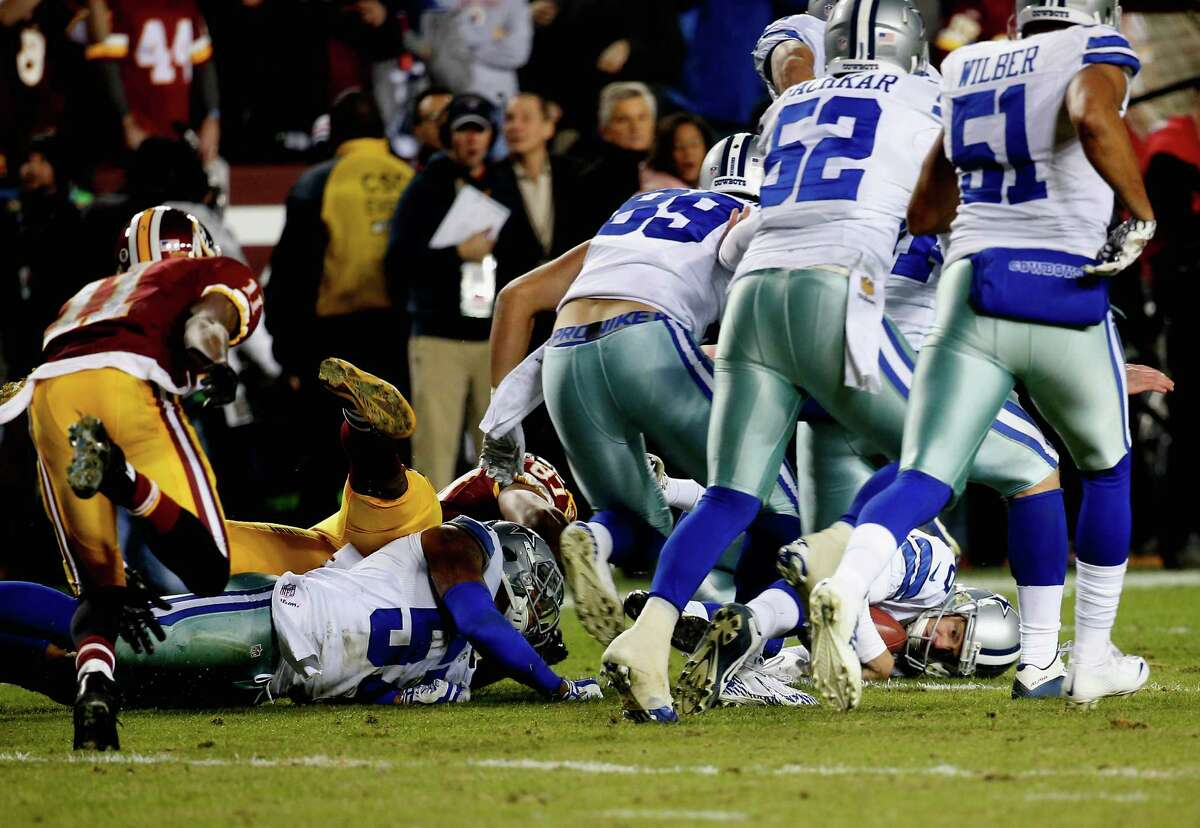 Punter Chris Jones of Dallas recovers a fumbled punt by wide receiver DeSean Jackson of the Washington Redskins late in the second half of the Cowboys' 19-16 win at FedExField on Dec. 7, 2015.