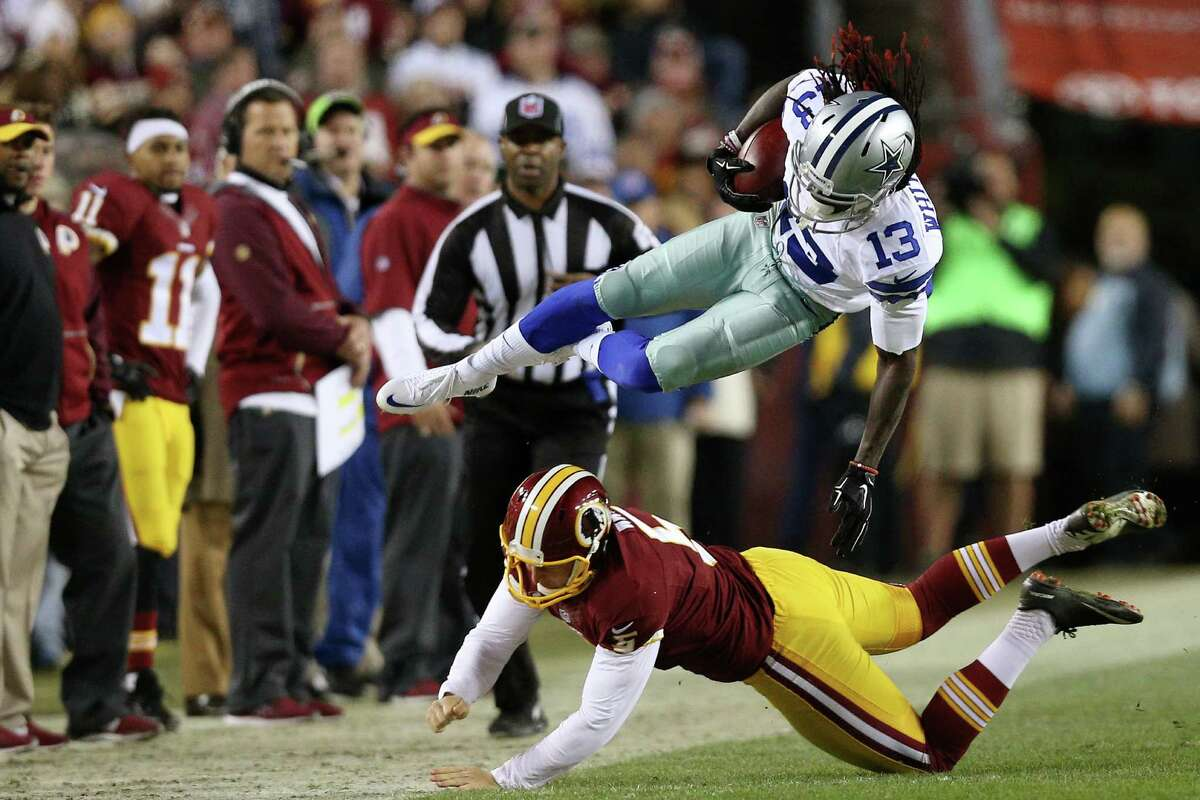 Lucky Whitehead of the Dallas Cowboys is knocked out of bounds by punter Tress Way of the Washington Redskins in the first quarter at FedExField on Dec. 7, 2015.