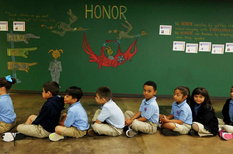 Students sit quietly in the hallway Tuesday, Sept. 15, 2015, in Houston.  Kipp has shown strong academic results as the charter chain has grown. Kipp connect is one of the newest campuses in the chain. Looking for general shots of kids in class/doing their school work.( Steve Gonzales / Houston Chronicle ) Photo: Steve Gonzales, Staff / © 2015 Houston Chronicle