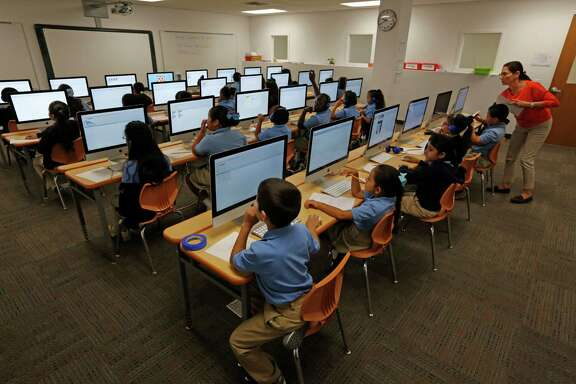 Kipp students work in the computer lab Tuesday, Sept. 15, 2015, in Houston. Kipp has shown strong academic results as the charter chain has grown. Kipp connect is one of the newest campuses in the chain. Looking for general shots of kids in class/doing their school work. ( Steve Gonzales / Houston Chronicle )