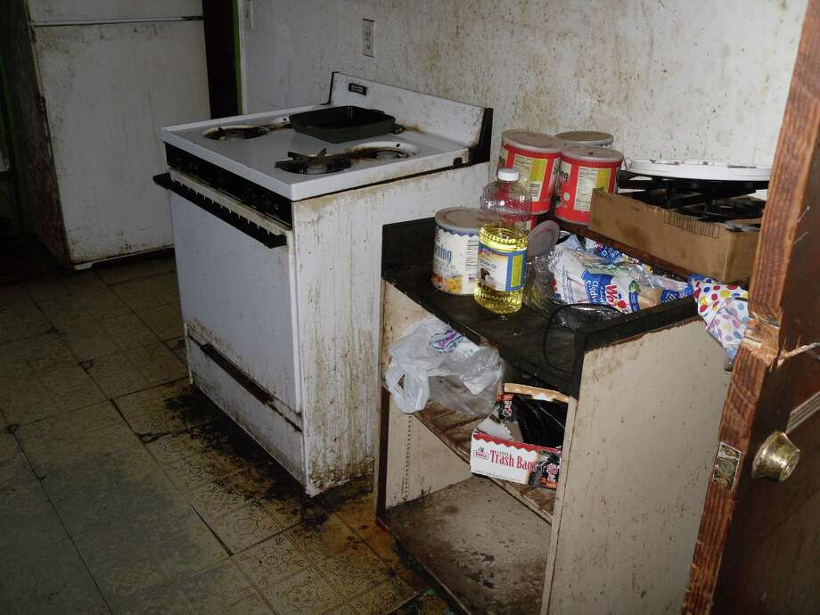According to the Houston Police Department (HPD), the living conditions in some local boarding homes are unsanitary, as is the case with the litchen shown in this photograph. Photo: Courtesy Of  Houston Police Dpt. / Copyright 2009