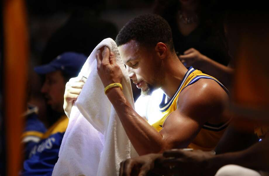 Golden State Warriors' Stephen Curry is bathed in light during a time out during Warriors' 131-123 win over Indiana Pacers in NBA game at Bankers Life Fieldhouse in Indianapolis, Indiana on Tuesday, December 8, 2015. Photo: Scott Strazzante, The Chronicle