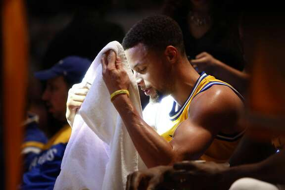 Golden State Warriors' Stephen Curry is bathed in light during a time out during Warriors' 131-123 win over Indiana Pacers in NBA game at Bankers Life Fieldhouse in Indianapolis, Indiana on Tuesday, December 8, 2015.