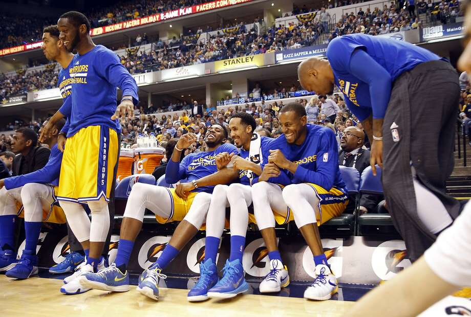 Golden State Warriors' Jason Thompson, Shaun Livingston and Andre Iguodala enjoy a 3rd quarter basket during Warriors' 131-123 win over Indiana Pacers during NBA game at Bankers Life Fieldhouse in Indianapolis, Indiana on Tuesday, December 8, 2015. Photo: Scott Strazzante, The Chronicle