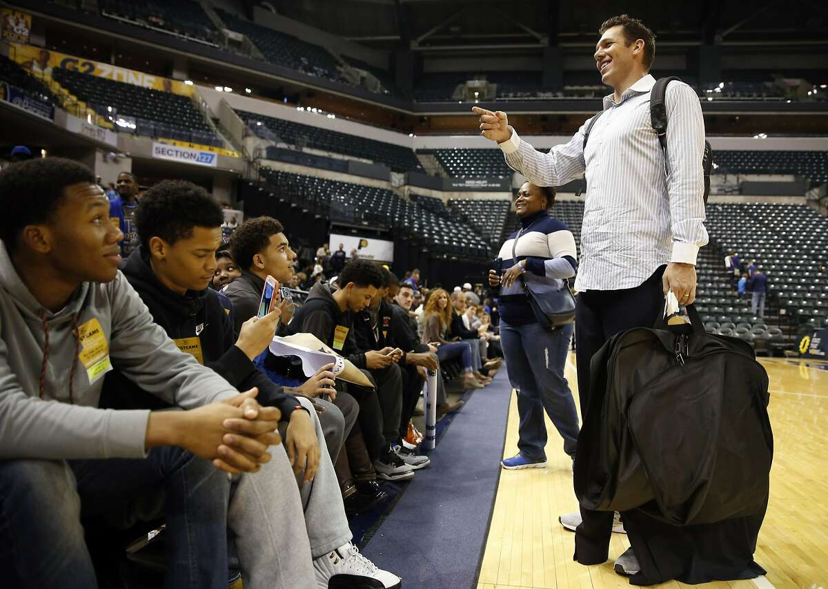 Golden State Warriors' interim head coach Luke Walton visits with Peoria Central High School students after Warriors' 131-123 win over Indiana Pacers at Bankers Life Fieldhouse in Indianapolis, Indiana on Tuesday, December 8, 2015.