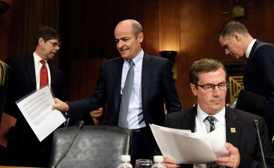 Anheuser-Busch InBev Chief Executive  Officer Carlos Brito, second from left, walks past Brewers Association Chief Executive Officer Bob Pease, second from right, as he arrives to testify before the Senate Antitrust, Competition Policy and Consumer Rights Subcommittee on Capitol Hill in Washington, Tuesday, Dec. 8, 2015, before a hearing on the proposed $107 billion takeover by the world's largest brewer, Anheuser Busch InBev, of rival SABMiller. The combined company would control nearly a third of the global beer market.(AP Photo/Susan Walsh) Photo: Susan Walsh, STF / AP