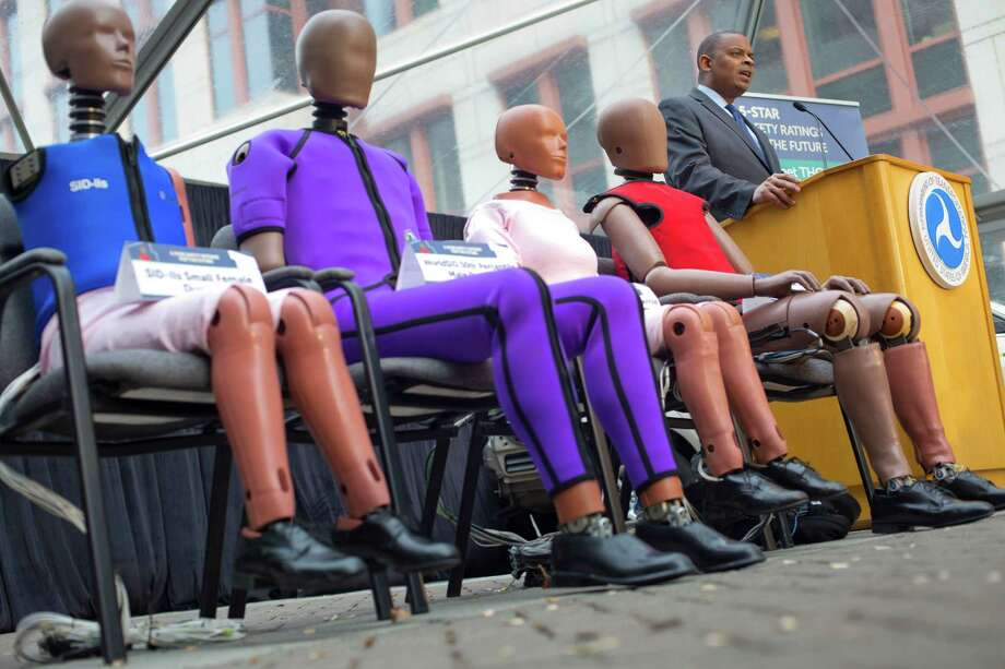 Transportation Secretary Anthony Foxx, with new crash test dummies, announces plans Tuesday for updating safety ratings for new cars. Photo: Pablo Martinez Monsivais, STF / AP