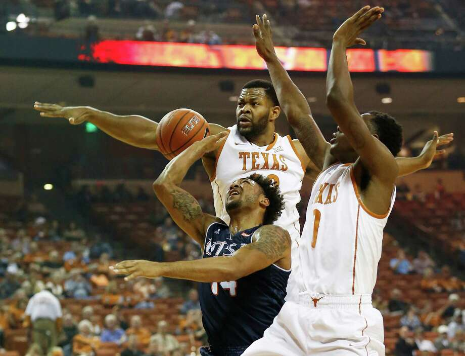 UTSA's Ryan Bowie (14) gets a shot blocked by Texas' Shaquille Cleare (32) and Isaiah Taylor (01) in Austin on Tuesday, Dec. 8, 2015. (Kin Man Hui/San Antonio Express-News) Photo: Kin Man Hui, Staff / San Antonio Express-News / ©2015 San Antonio Express-News