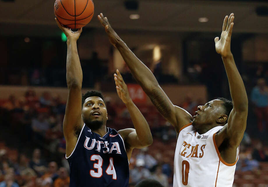 UTSA's Nick Billingsley (34) attempts a shot against Texas' Tevin Mack (00) and Kendal Yancy (05) in Austin on Tuesday, Dec. 8, 2015. The Longhorns defeated the Roadrunners, 116-50. (Kin Man Hui/San Antonio Express-News) Photo: Kin Man Hui /San Antonio Express-News / ©2015 San Antonio Express-News