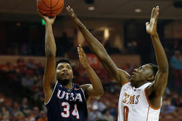 UTSA's Nick Billingsley (34) attempts a shot against Texas' Tevin Mack (00) and Kendal Yancy (05) in Austin on Tuesday, Dec. 8, 2015. The Longhorns defeated the Roadrunners, 116-50. (Kin Man Hui/San Antonio Express-News)