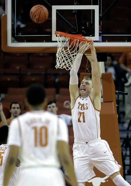Texas' Connor Lammert tests the bend in the rim while missing a dunk on a night when little else went wrong for the Longhorns in a 66-point rout of UTSA. Photo: Eric Gay, STF / AP
