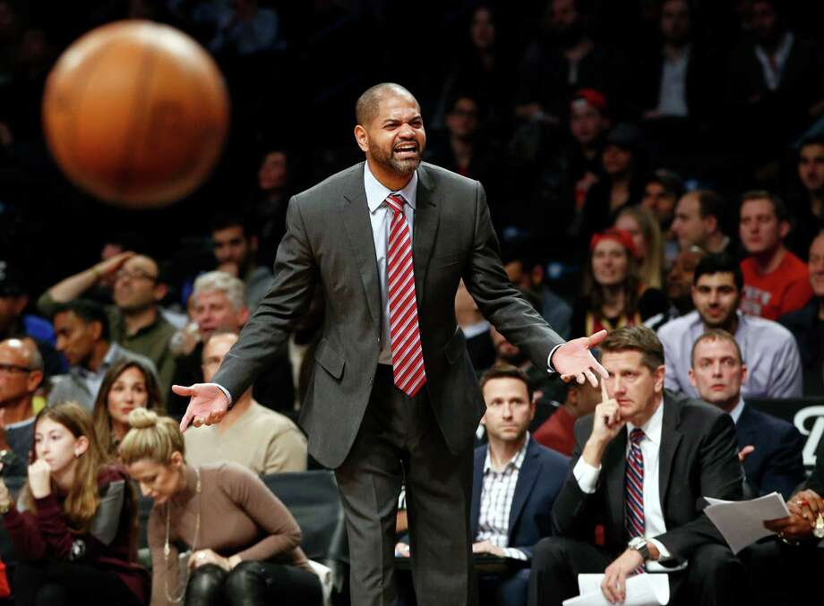 It's fitting that as coach J.B. Bickerstaff protests a call, the ball gets away, something it did 24 times to the turnover-prone Rockets on Tuesday night.  Photo: Kathy Willens, STF / AP