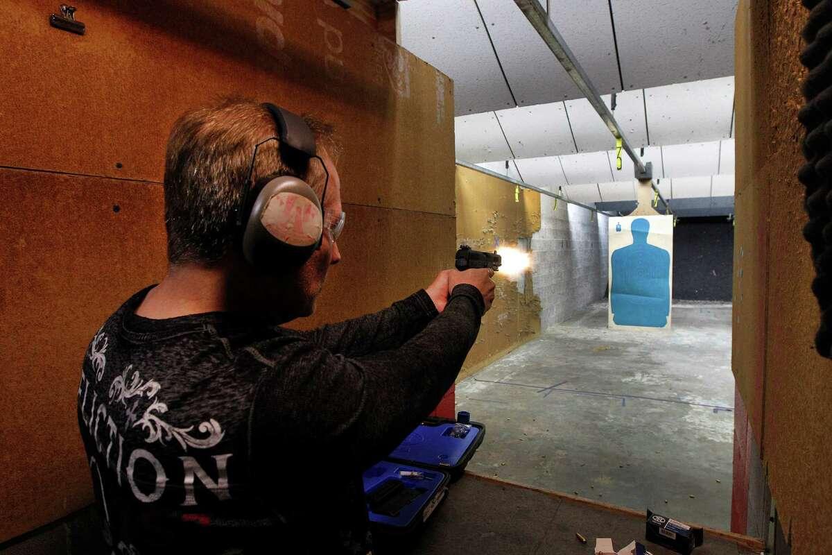 Johnnie Jackow fires his new FN Herstal Five Seven 5.7 x 28 gun he purchased at Full Armor Gun Range, 11911 Katy Freeway Monday, Dec. 7, 2015, in Houston.