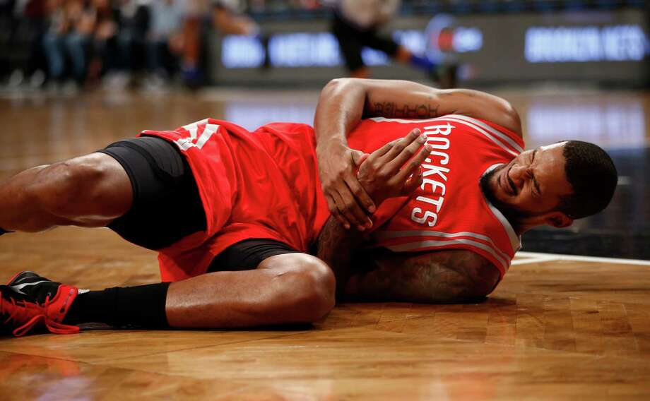 Trevor Ariza injured his back in the first quarter Tuesday night. Photo: Kathy Willens, STF / AP