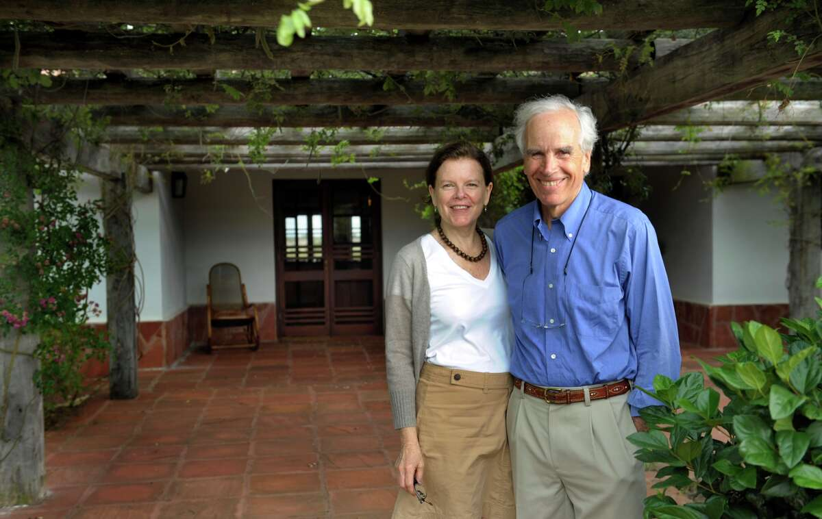Douglas Tompkins and his wife Kristine pose in the front of their house at the estate