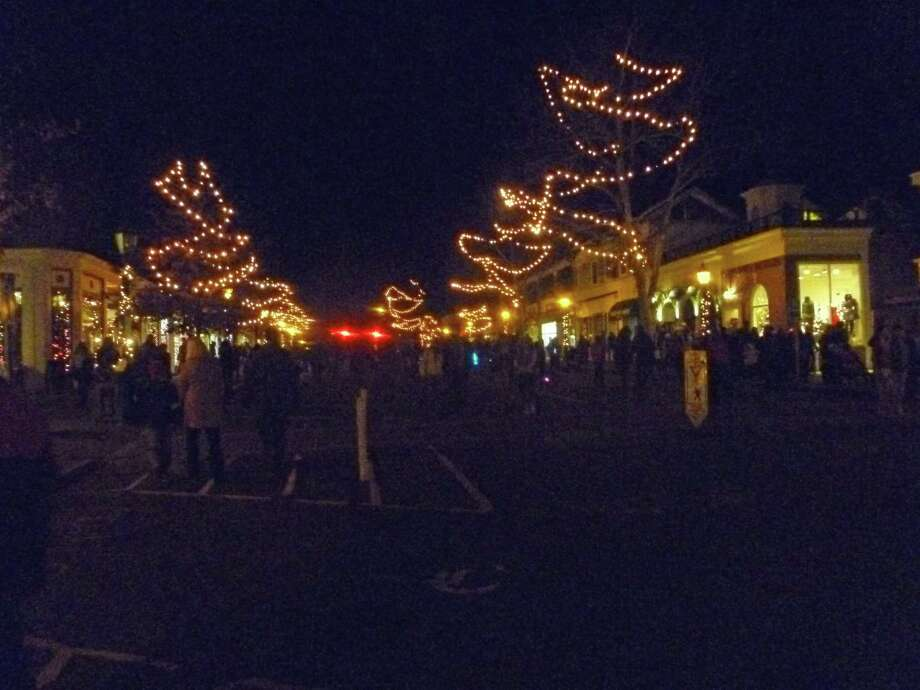 Downtown visitors made their way up Elm Street on the night of Friday,  Dec. 4, for the 11th annual New Canaan  Chamber of Commerce Holiday Stroll. Photo: Martin Cassidy / Hearst Connecticut Media / New Canaan News