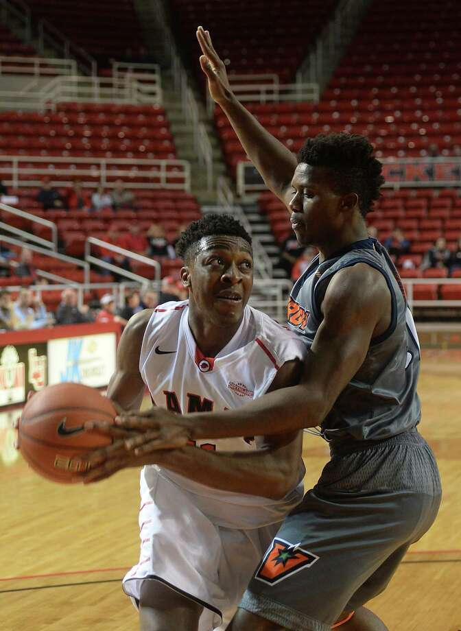 Lamar's Josh Nzeakor eyes the basket as he maneuvers around UT Rio Grande Valley's Adonis Rwabigwi during Wednesday's game at the Montagne Center. Photo taken Wednesday, December 02, 2015 Kim Brent/The Enterprise Photo: Kim Brent / Beaumont Enterprise