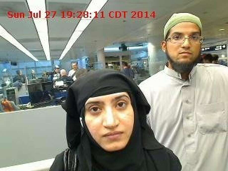 In this photo provided by U.S. Customs and Border Protection, Tashfeen Malik (L) and Syed Farook arrive at O'Hare Airport July 27, 2014 in Chicago, Illinois. The FBI has officially labeled the attack carried out by Farook and his wife Malik as an act of terrorism. The San Bernardino community continues to mourn the attack at the Inland Regional Center in San Bernardino that left at least 14 people dead. Photo: Handout, Getty Images