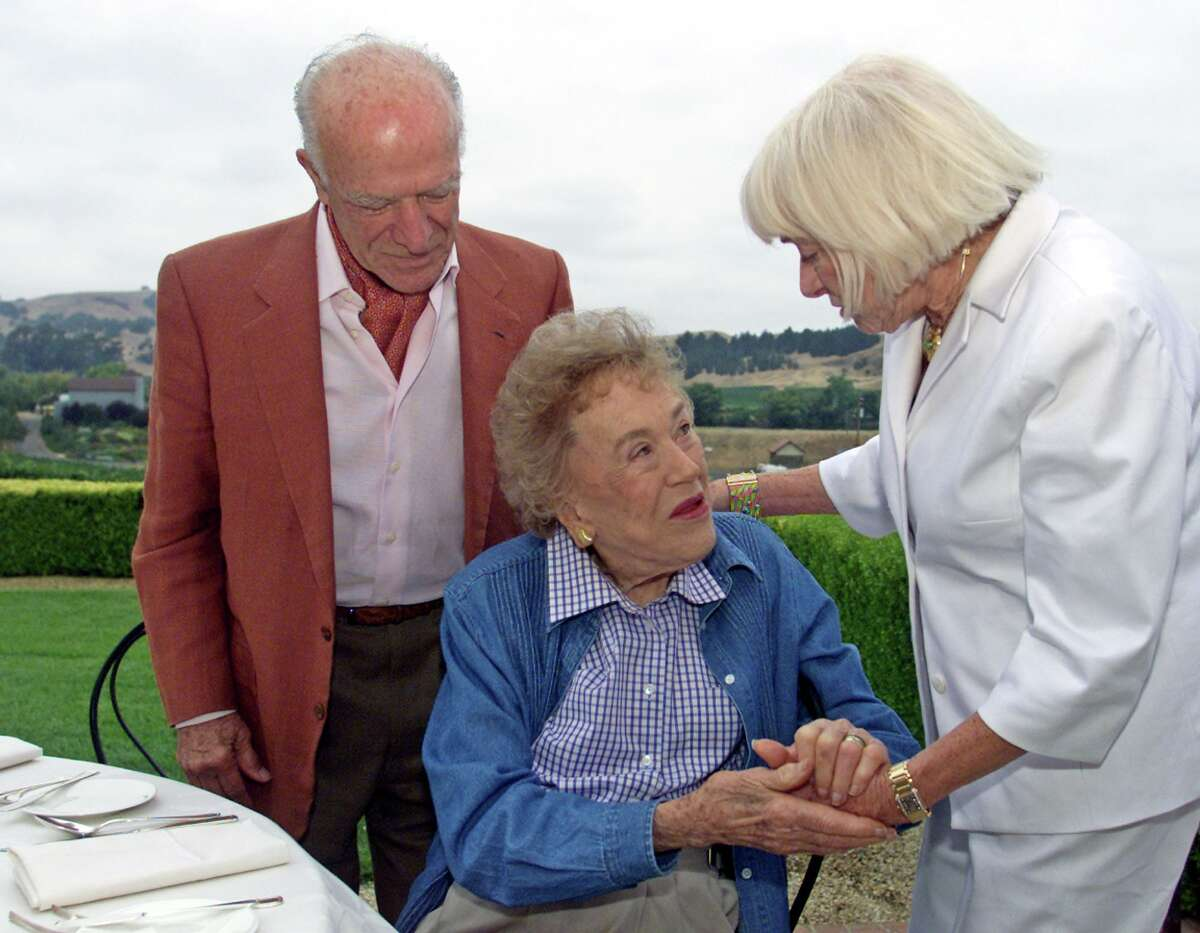 Julia Child, center, is given 90th birthday wishes from winemaker Robert Mondavi, left, and his wife Margrit Biever Mondavi, right, during a birthday brunch at the Domaine Carnerors winery in Napa, Calif., Saturday, Aug. 3, 2002.