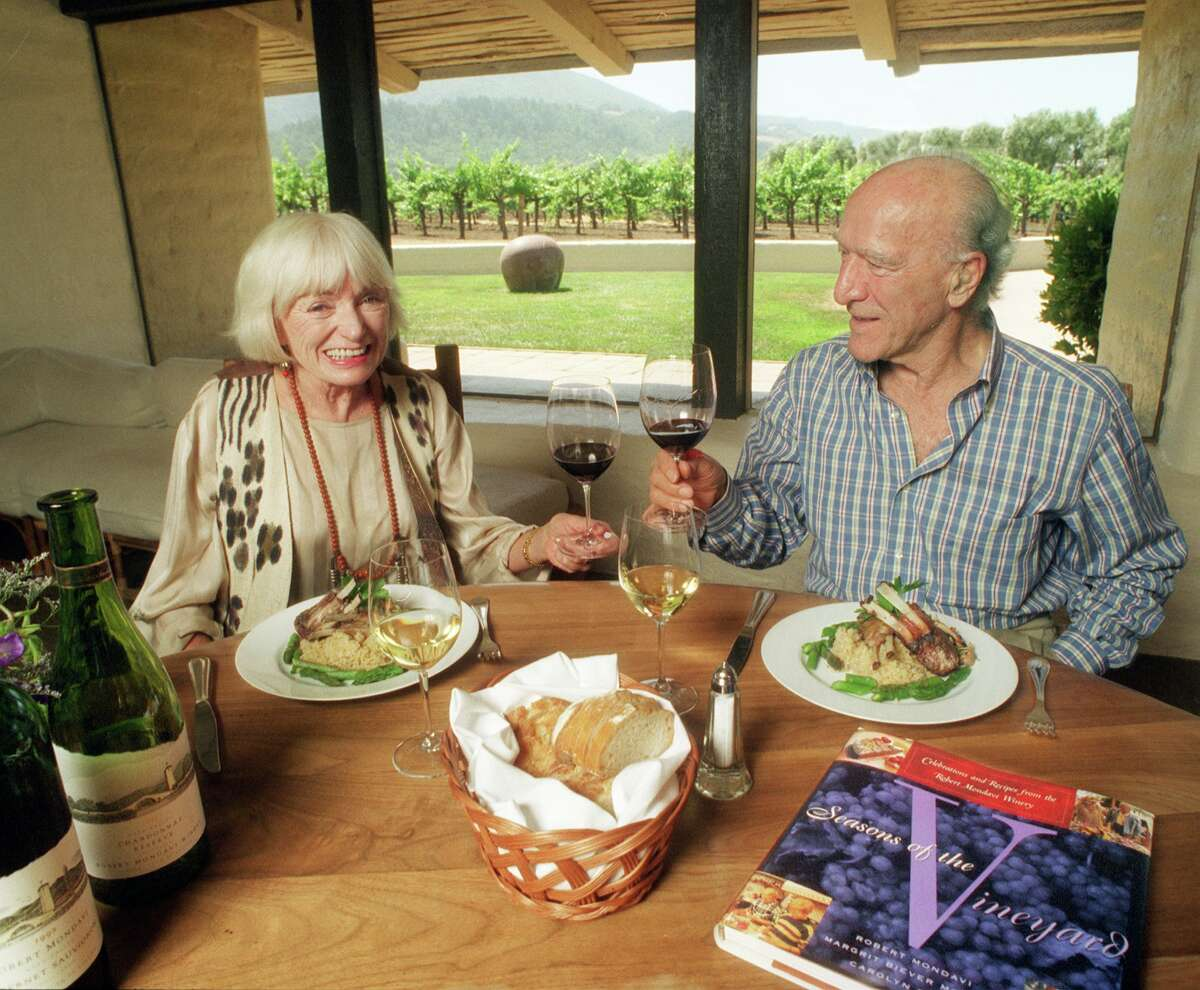 In this undated file photo, Robert Mondavi and his wife Margrit Biever Mondavi, at lunch at the Mondavi Winery.