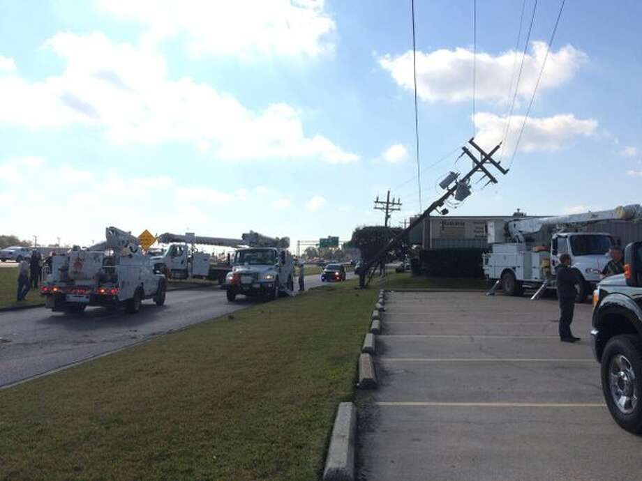 A utility pole is down after high-speed chase led to an accident Wednesday at Interstate 10 west access road near Washington. Beaumont police say the chase stemmed from a home and auto burglary earlier Wednesday. Photo: Kim Brent/The Enterprise