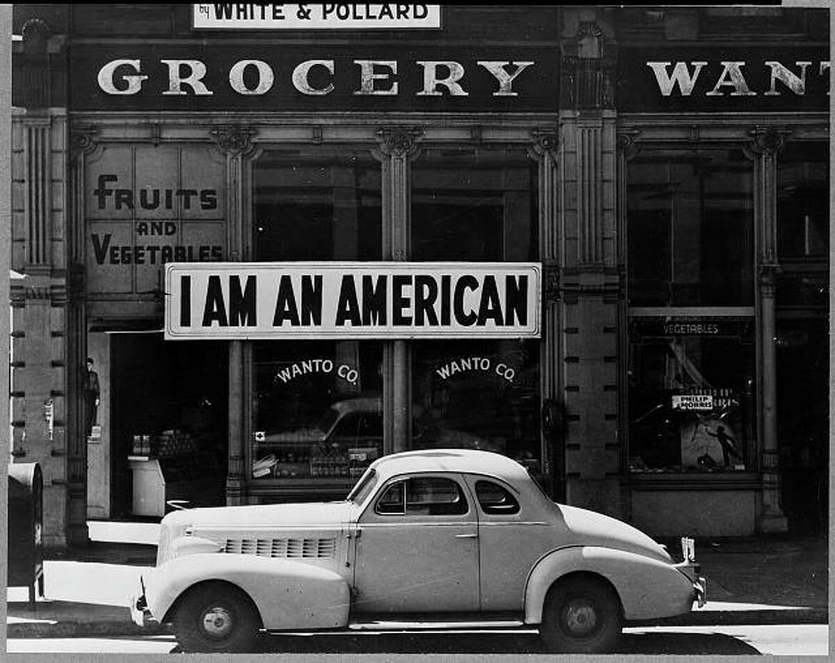 This photo shows a sign placed in the window by Japanese-American owners of an Oakland store on December 8, the day after Pearl Harbor.