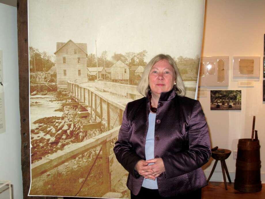 Darien Historical Society Executive Director Judy Groppa walks through the society's newest exhibit on Wednesday, her last full day on the job. Photo: Maggie Gordon / Darien News