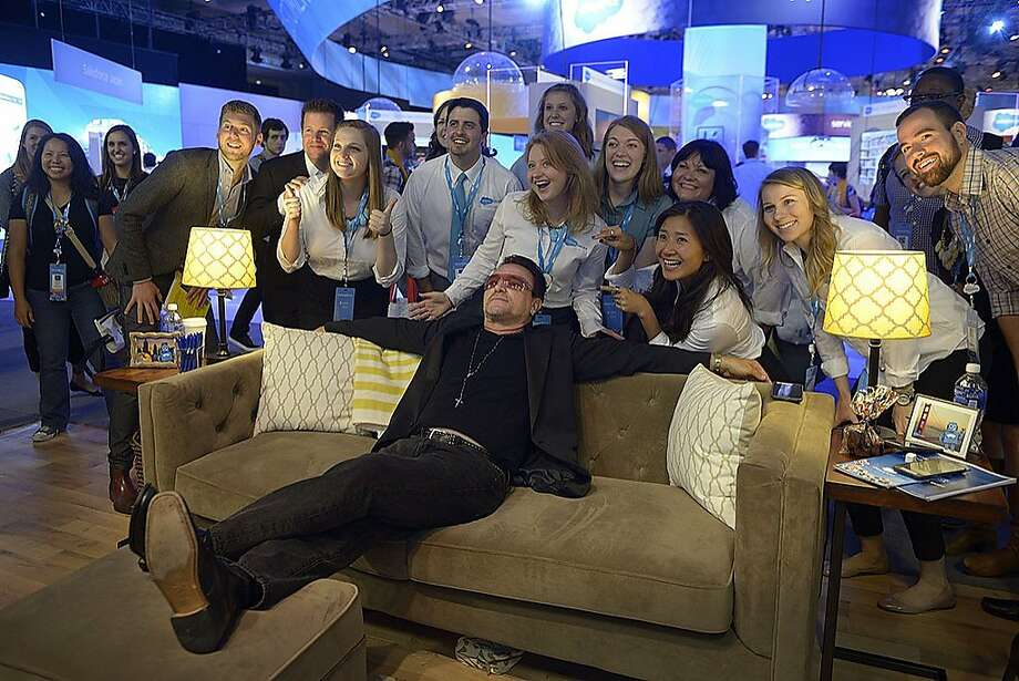 A Bono look-alike poses for photographs at a Salesforce convention in San Francisco.