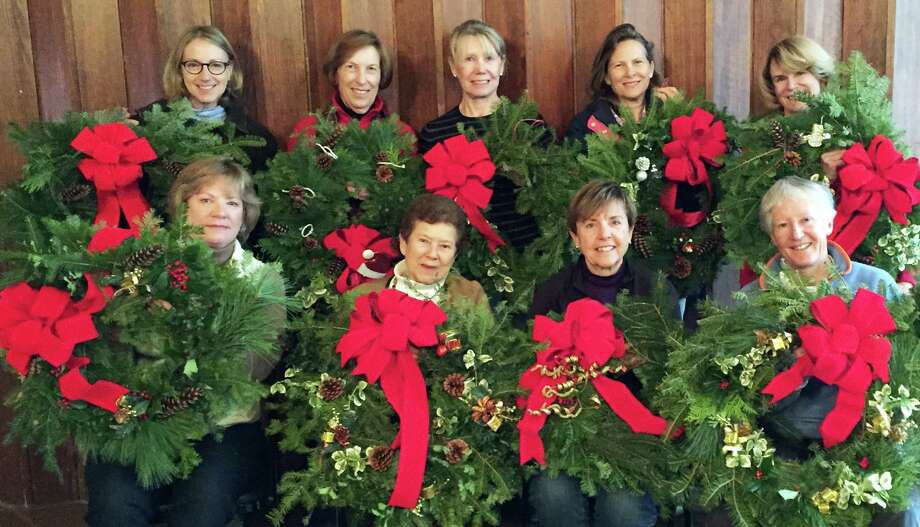 Members of the Greens Farms Garden Club with wreaths they decorated for donation to train stations and area organizations include, first row from left, Carol MacDonald of Southport, Betty Gosselin of Greens Farms, Cindy Fitzgerald of Westport and Betsy Hulme of Fairfield; back row, Sandy Lewis of Weston, Judy Reynolds of Southport, Maren Hood of Darien, Ann Watkins of Fairfield and Chris Supernaw of Southport. Photo: Contributed / Contributed Photo / Westport News