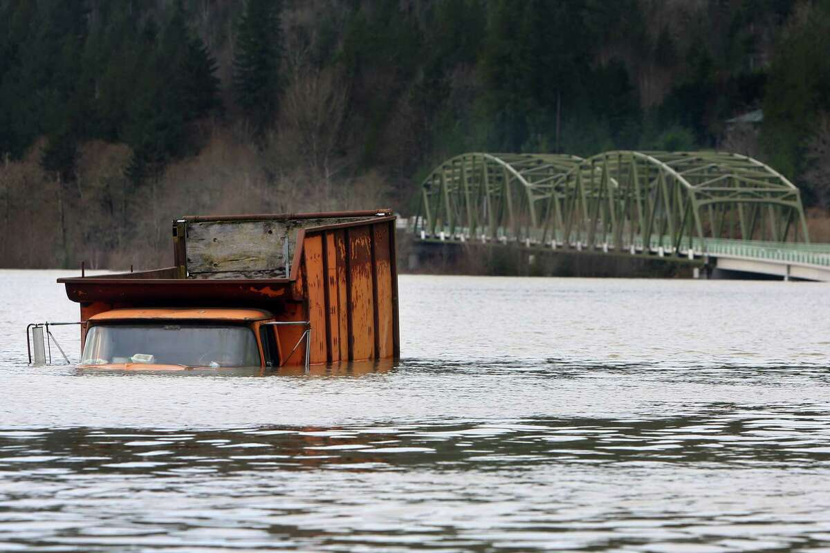 A truck is submerged in Snoqualmie River floodwaters off of Tolt Hill Road in Carnation, Wednesday, Dec. 9, 2015. The Snoqualmie River reached severe flood levels late Tuesday.