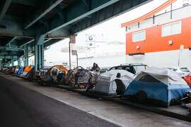 Tents set up under the 101 offramp at Division and Folsom Streets in San Francisco, Calif., Wednesday, December 9, 2015.