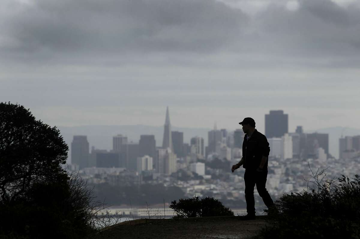 Charlie Wong of Sacramento takes in the view of San Francisco from the Marin Headlands on Wednesday, Dec. 9, 2015, ahead of tomorrow's rainstorm.