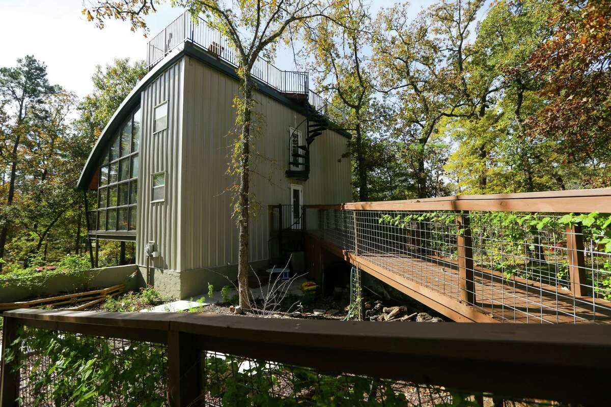 The Younkins built a wooden bridge that serves as a ramp up to the back of their home.
