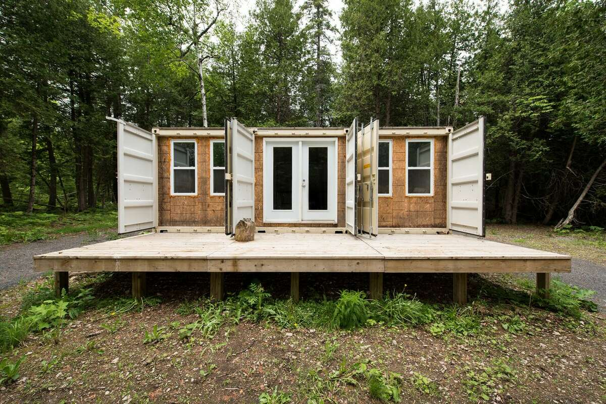 It may look like a heap of junk from the outside but a peek inside a three combined, 355-square-foot shipping containers reveals a minimalistic, $43,677 pad.