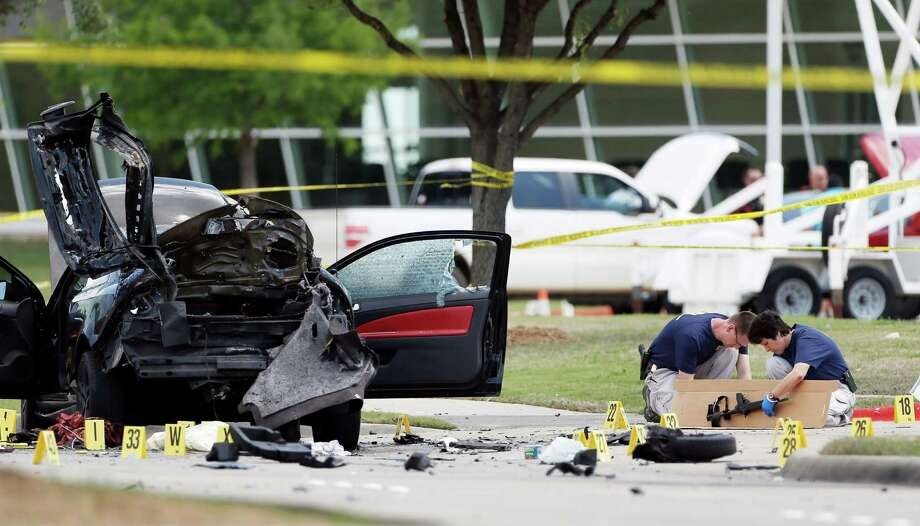Investigators collect evidence outside the Curtis Culwell Center in Garland on May 4. A Phoenix- area man was charged with helping plan an attack on a Prophet Muhammad cartoon contest. Photo: Brandon Wade /Associated Press / FR168019 AP