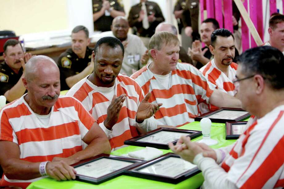 Inmates are awarded residential air conditioning and wiring training certification from the Wharton County Junior College Continuing Education Program through the Inmate Vocational Center.  Photo: Gary Coronado, Staff / © 2015 Houston Chronicle