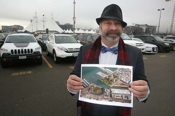 Real estate agent Donald Dewsnup shows the parking lot near AT&T park where housing projects were approved in San Francisco, California, on Wednesday, December 9, 2015.