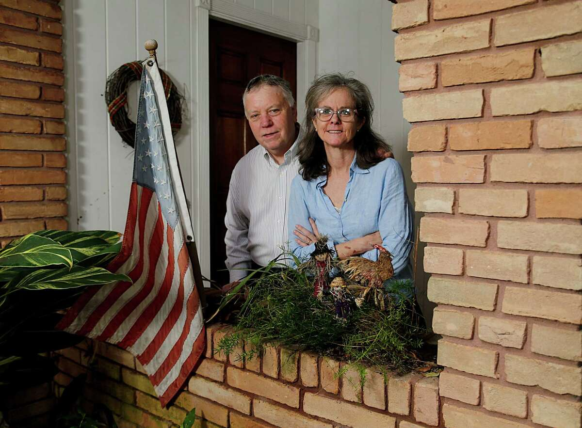 David Wolf and his wife, Mary Ellen Wolf, stand on the porch of their West University home, which is at the center of a foreclosure dispute. ( James Nielsen / Houston Chronicle )
