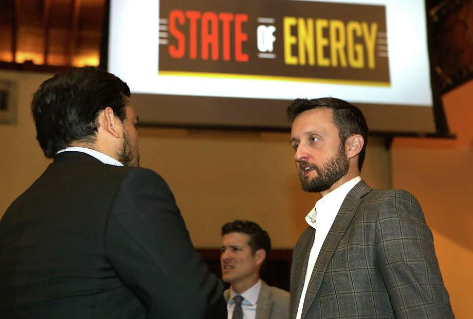 Brandon Seale (right), president of Howard Energy Mexico, talks with Justin Witherspoon of MassMutal South Texas Financial Group at the State of Energy luncheon Wednesday at the Pearl Stable. Photo: Bob Owen /San Antonio Express-News / San Antonio Express-News