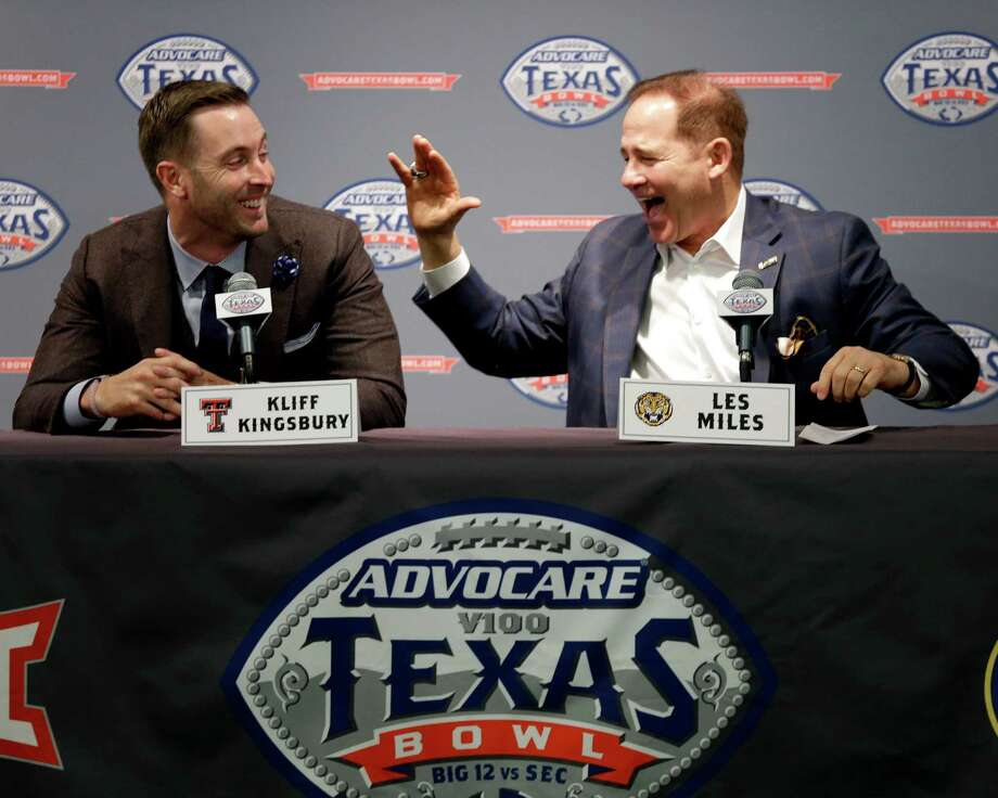 LSU coach Les Miles, right, laughs at Texas Tech coach Kliff Kingbury's answer to a question during a Texas Bowl football news conference Tuesday, Dec. 8, 2015, in Houston. Texas Tech will play LSU in the Texas Bowl Dec. 29th at NRG Stadium in Houston. (AP Photo/David J. Phillip) Photo: David J. Phillip, STF / AP