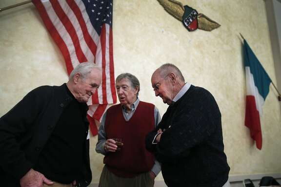 "From left, Tim Cadigan, Stan Buchanan and Jim Stephens swap stories at an annual holiday luncheon for a group of men calling themselves ""the luckiest generation"" at the Italian Athletic Club in San Francisco, Calif. on Wednesday, Dec. 9, 2015."