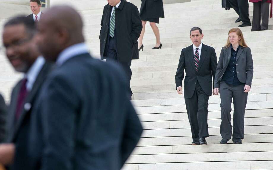 Abigail Fisher, who challenged the use of race in college admissions, right, walks with lawyer Edward Blum following oral arguments in the Supreme Court in Washington, Wednesday, Dec. 9, 2015, in a case that could cut back on or even eliminate affirmative action in higher education. At far left is Gregory J. Vincent, left, the University of Texas vice president for diversity, and other members of the UT group. (AP Photo/J. Scott Applewhite) Photo: J. Scott Applewhite, STF / Associated Press / AP