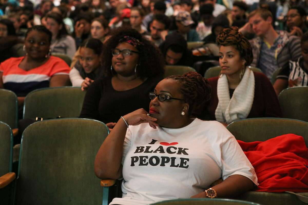 Dr. Keisha Hicks (center) listens to a press conference about racism and prejudice, at Berkeley High School, in Berkeley, California on Wednesday, December 9, 2015.