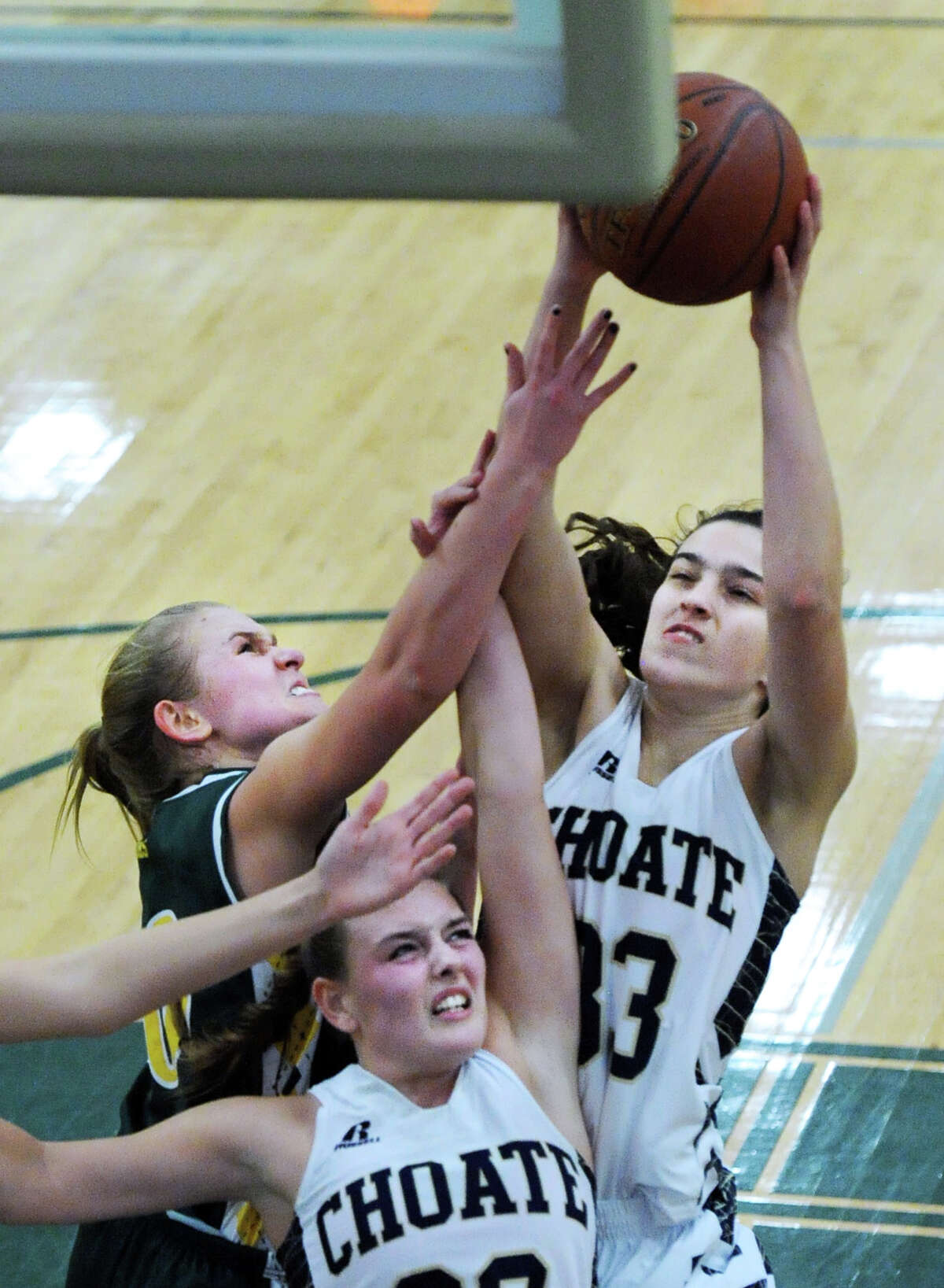 Nicole Sellew (#33) of Choate takes a shot as Greenwich Academy's Lucy Hudson (#5), left, attempts a block during the girls high school basketball game between Greenwich Academy and Choate Rosemary Hall at Greenwich Academy, Conn., Wednesday, Dec. 9, 2015. At bottom left is Choate's Gabrielle Brooks (#22).