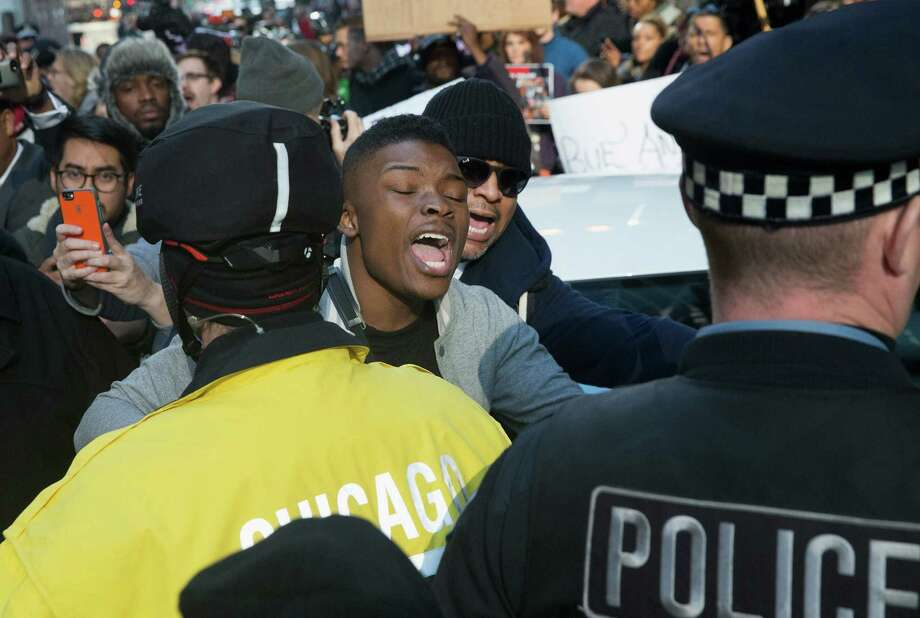 Hundreds of protesters calling for the resignation of Chicago Mayor Rahm Emanuel march through downtown. Photo: Scott Olson /Getty Images / 2015 Getty Images