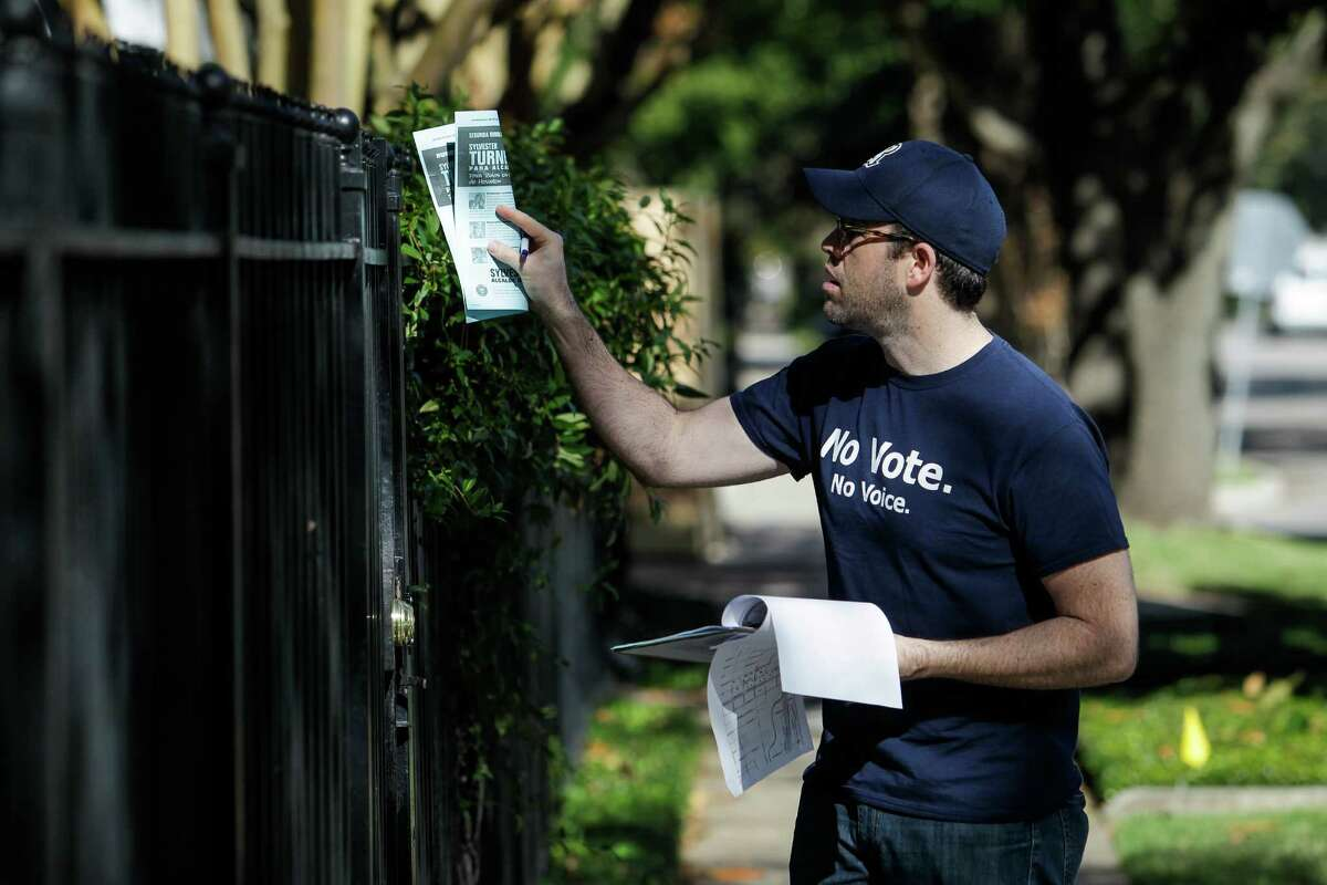 State Rep. Jim Murphy, top, gives a pep talk to block walkers with the Harris County Republican Party. Meanwhile, Battleground Texas volunteer TJ Hoffman leaves a flier for residents along Cortland Street in the Heights.