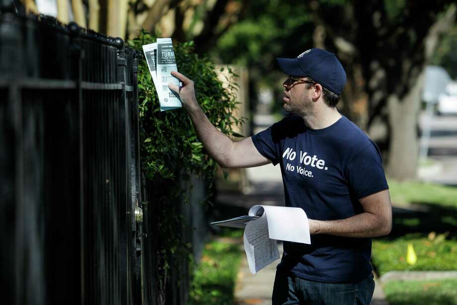 State Rep. Jim Murphy, top, gives a pep talk to block walkers with the Harris County Republican Party. Meanwhile, Battleground Texas volunteer